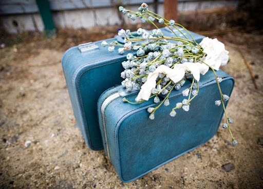 blue suitcases wedding flowers