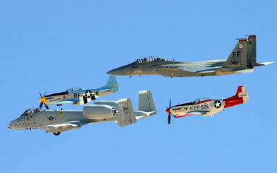 An F-15D Eagle, P-51 Mustangs, and an A-10 Thunderbolt II team up during an air show