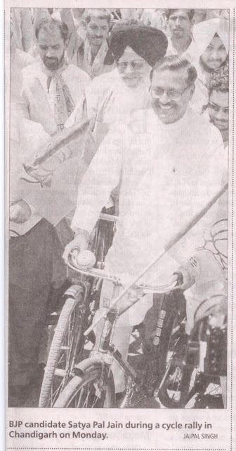BJP candidate Satya Pal Jain during a cycle rally in Chandigarh on Monday.