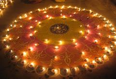 देव दीपावली पर रामघाट पर बनाया गया रंगोली और दियों का अद़भुद समिश्रण