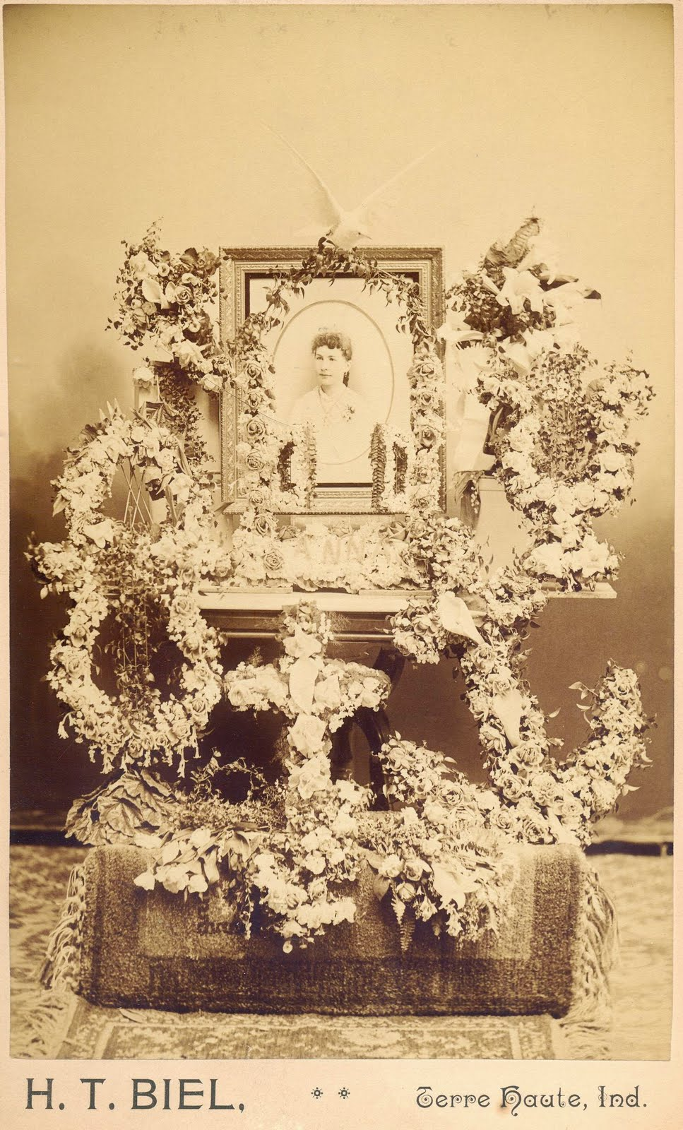 A land of deepest shade victorian home memorial shrines representations of the cross the anchor and the lyre are included as well as the gates of heaven crowned with a dove izmirmasajfo