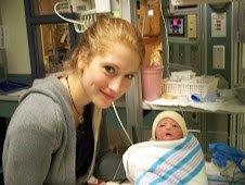 big sister Samantha and Rachel moments after her birth