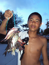 MeMong and the fish he caught spearfishing