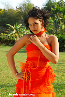 Actress 'Sania' Hot Stills in Orange Dress http://rkwebdirectory.com