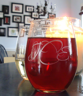 Custom wine glasses DIYed with the Cricut etched glass vinyl.