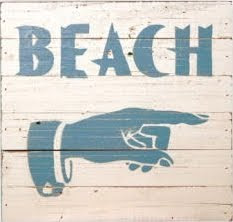 wood beach sign with hand