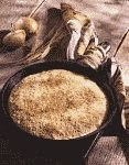 color photograph of a quick bread baked in a cast iron skillet