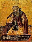 A color photo of an icon of St. Sisoes contemplating the bones of Alexander the Great.