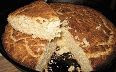 A color photo of a pone or round cake of cornbread.