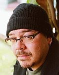 A color photo of Greg Rucka.