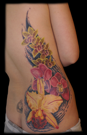 female back tattoo. lower ack flower tattoos