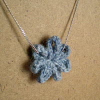 blue crocheted flower pendant necklace