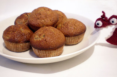 A pile of banana muffins, about to be devoured by a wild heart.
