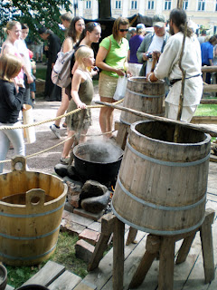 making the finnish beer sahti the traditional way at the medieval market in turku