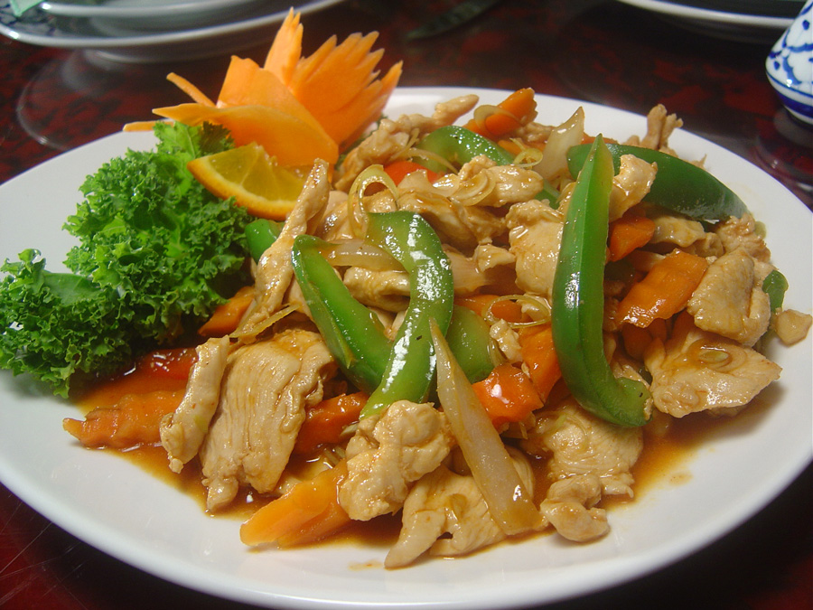 Stir-fried chicken with lemon grass, onions, carrots, bell pepper with ...