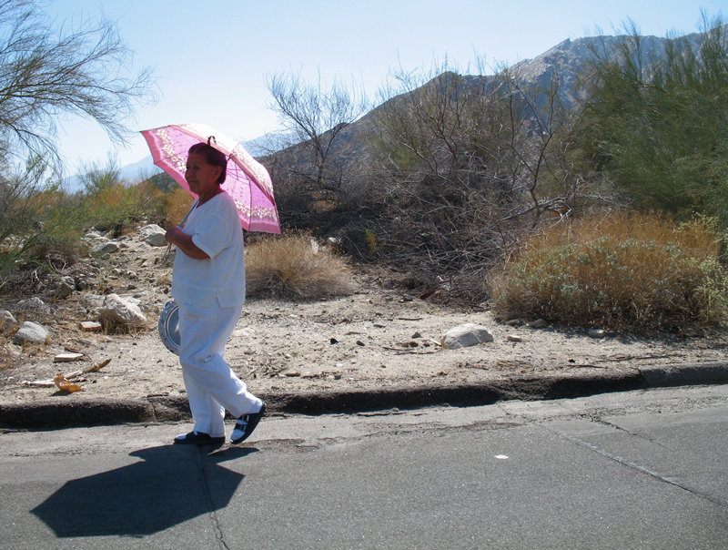 woman with pink umbrella; click for previous post