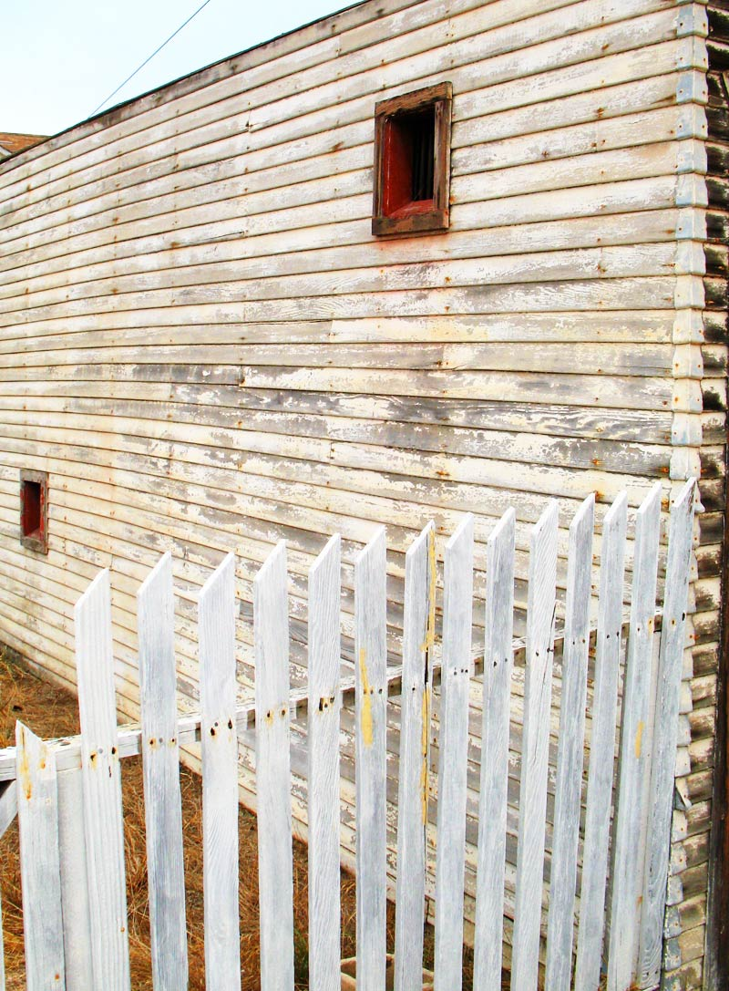 picket fence and weathered wall; click for previous post