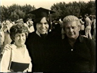 Mom & Dad with me at my college graduation.