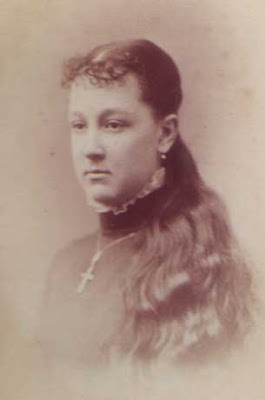 Young Woman with Long Hair and Cross Necklace