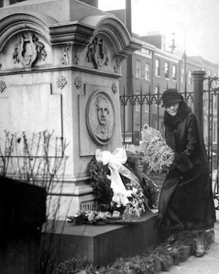 Lizette Reese Visiting Poe's Grave
