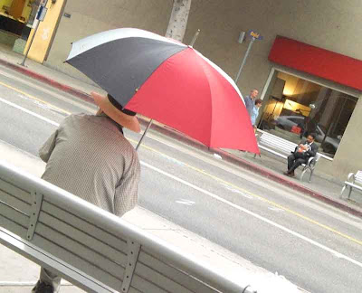 An Umbrella and A Hat is like A Belt and Suspenders