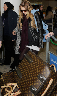Linday Lohan with Louis Vuitton Keep all and Pegase Luggage
