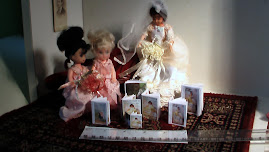 Dolls looking at DollVogue books.