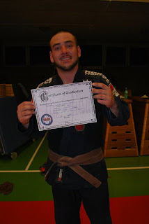 A proud Chris Arends with his new belt and certificate