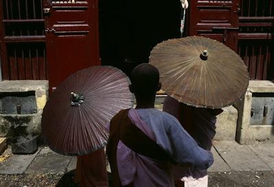 Monk with Umbrellas
