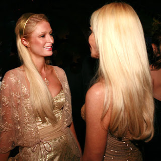 Paris Hilton portrays as Donatella Versace
