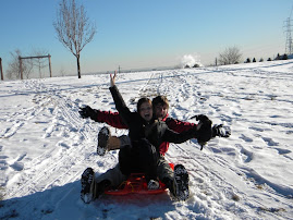 Brittany and Korey having fun sledding..