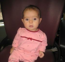 Sophia's first visit to my office and sitting in my chair!