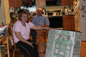 Grandma Linda and Grandpa Roger showing Savannah her birthday gift