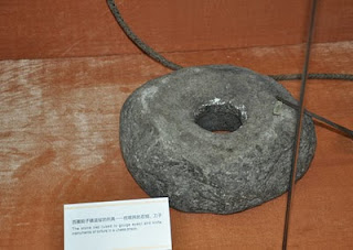 Propaganda item of a stone cap purportedly used for eye gouging.