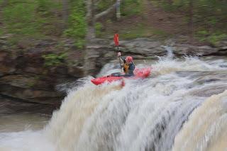 Kayaker at Fallingwater Falls