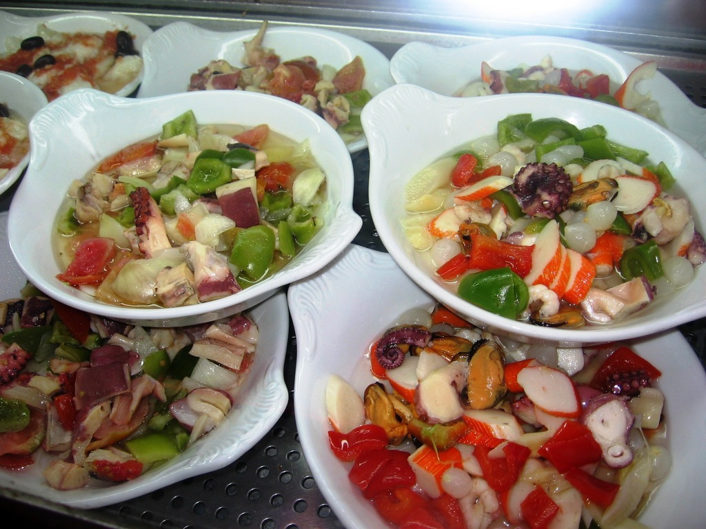 seafood salads (octopus, imitation crab meat, mussels, and ?)
