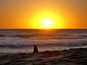 While enjoying the sunset at the beach in Swakopmund, Namibia, . (sealsunset)