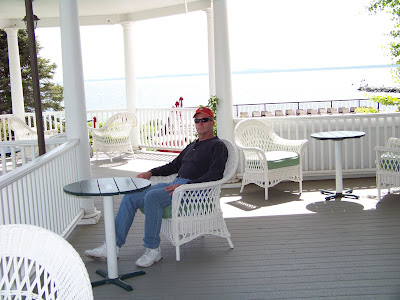 Here is hubby sitting on one of the porches.