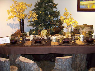 Isn't this outdoorsy tablescape fun? I like the way they mixed the