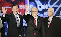 Republicans Romney, Giuliani and McCain at a presidential nominee debate in November 2007. Note how many aren't wearing lapel pins.