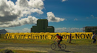 Greenpeace activists taking part in the global day of action on climate change outside the proposed coal burning power station Marsden B at Ruakaka, Northland.