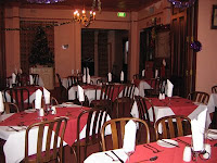 The guesthouse dining room all done up with Christmas decorations