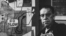el pintor estadounidense Stuart Davis ante una de sus obras en 1958