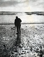 Ernest Bloch hunting his beloved agates in waders, a beret and a woolen cape on Agate Beach