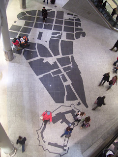 A map of the Stare Miasto on the floor of Galeria Krakowska