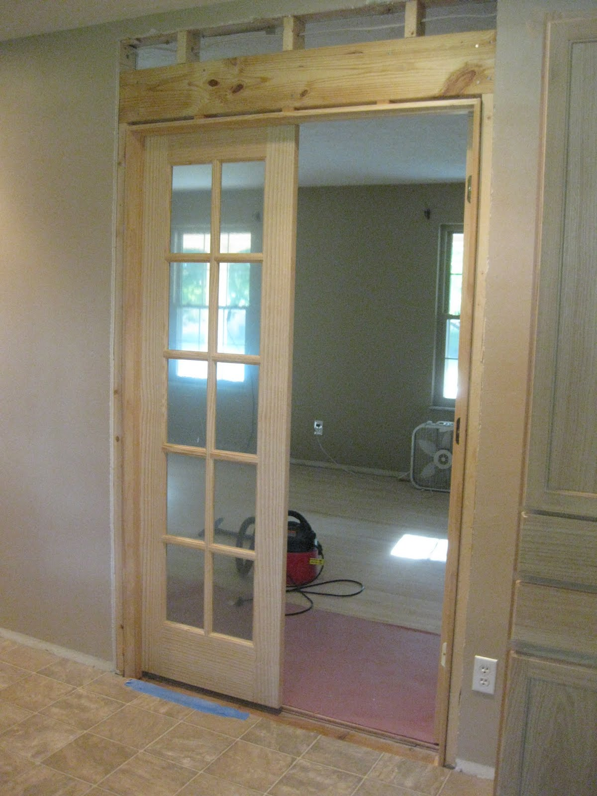 New and improving revealed french doors and living for Hardwood french doors