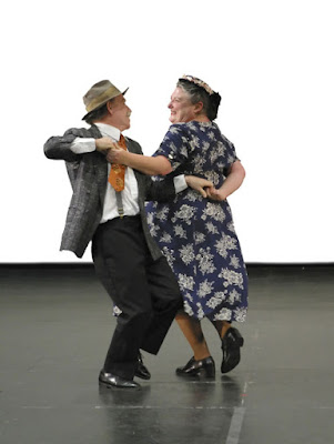 a very old couple dancing cutely