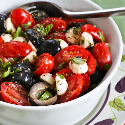 Tomato, Olive, and Fresh Mozzarella Salad with Basil Vinaigrette