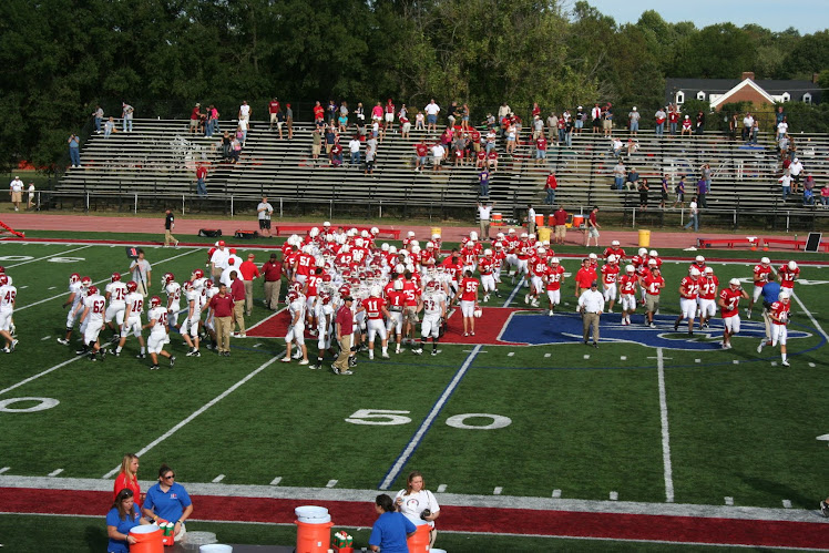 Rose Hulman and Hanover College players congratulate each other after the