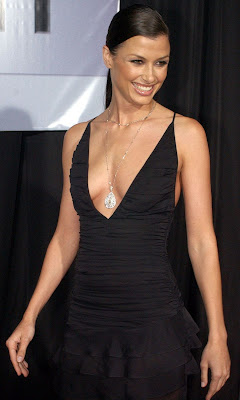 Bridget Moynahan black dress lowneck smile